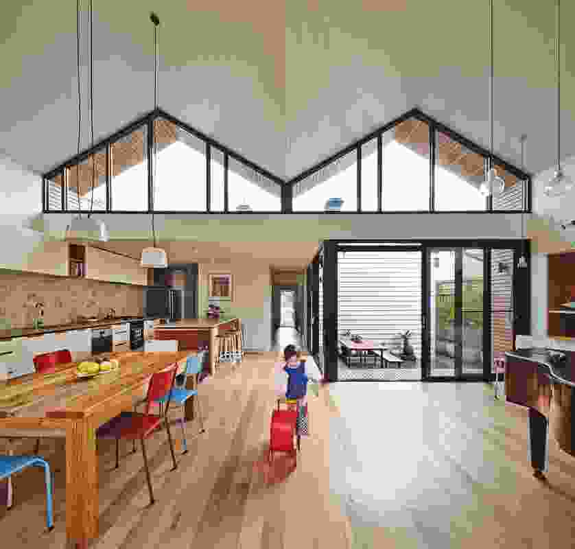 Striking clerestory windows funnel northern light into the extension, the winter sun falling onto the dining table.