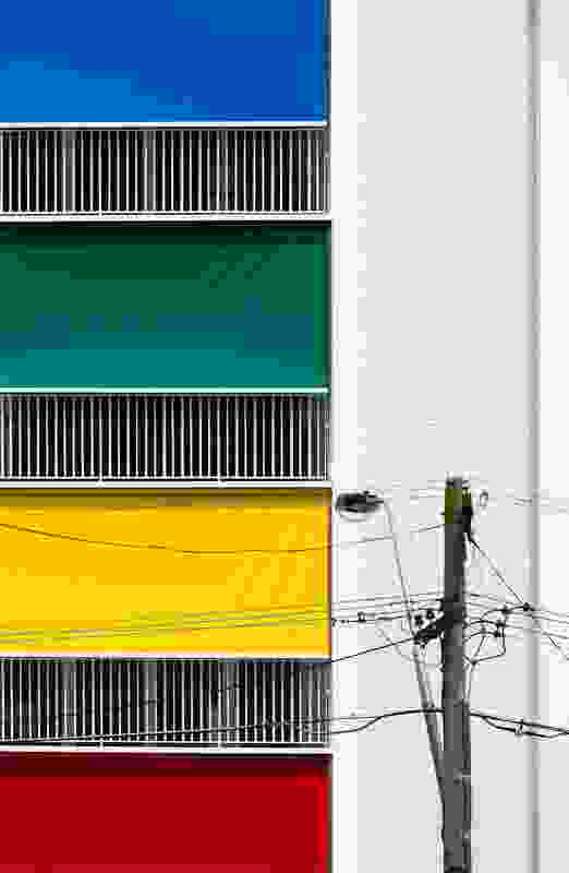 The building's colourful blinds contribute visually to the neighbourhood and provide a sense of identity – and shading – to the individual units.