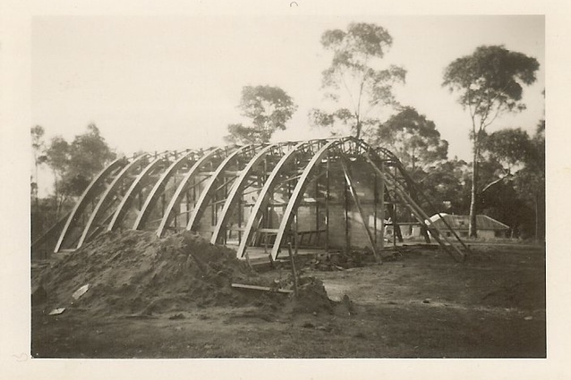 The Rice House by Kevin Borland under construction, showing catenary timber arches.