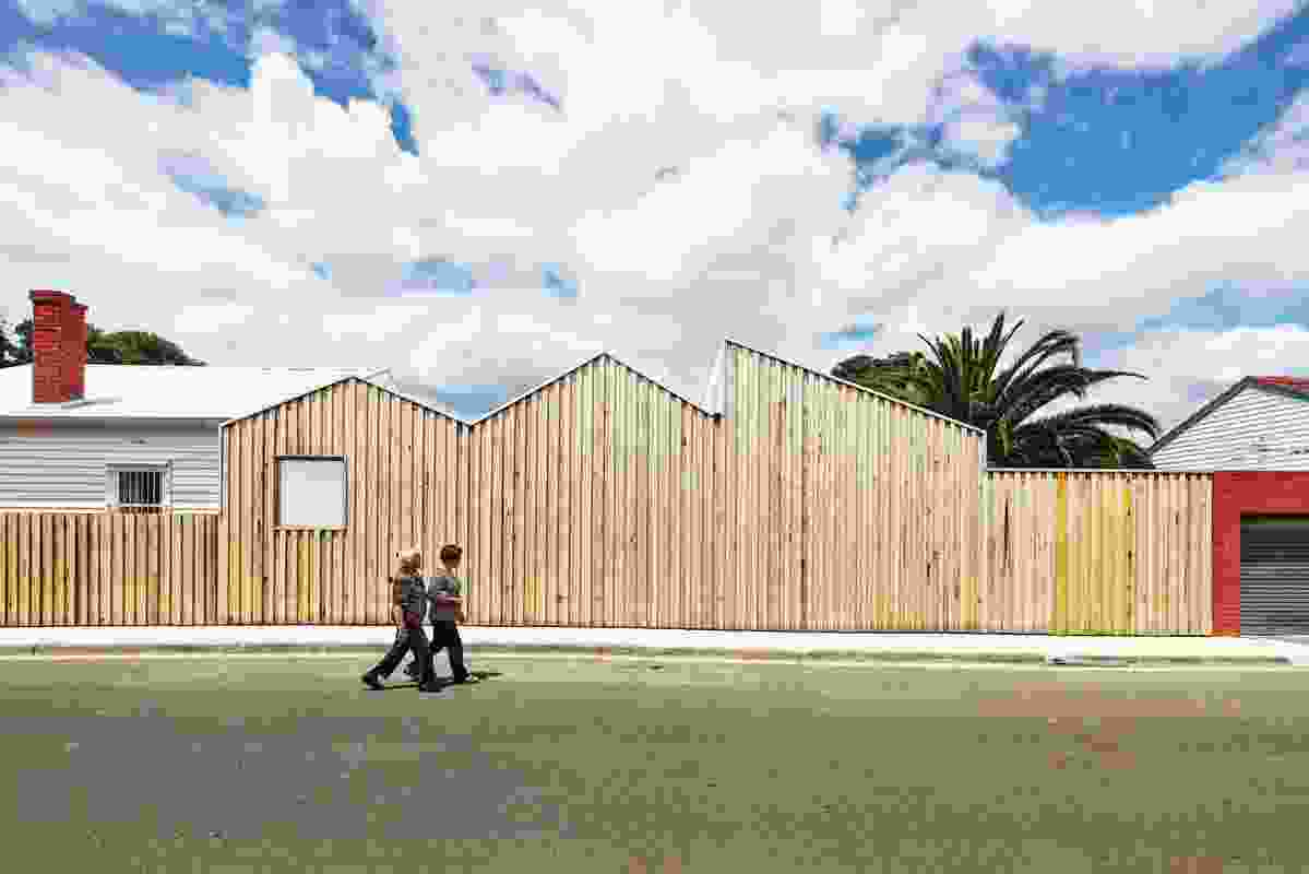 The western edge wall/fence follows the shape of the interior spaces.
