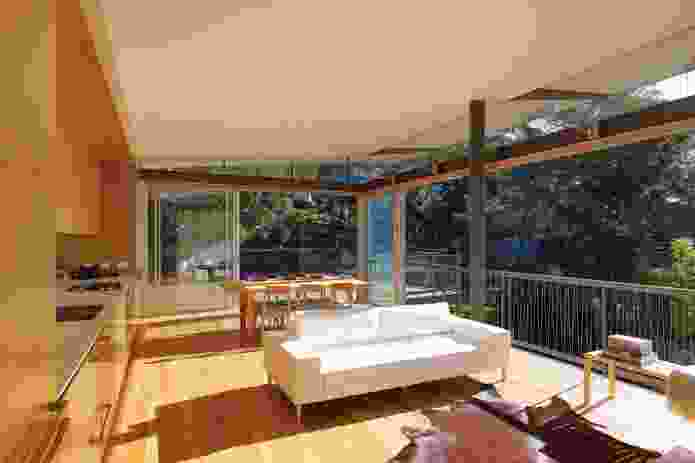 The living room opens to the north and spills into the entry deck.