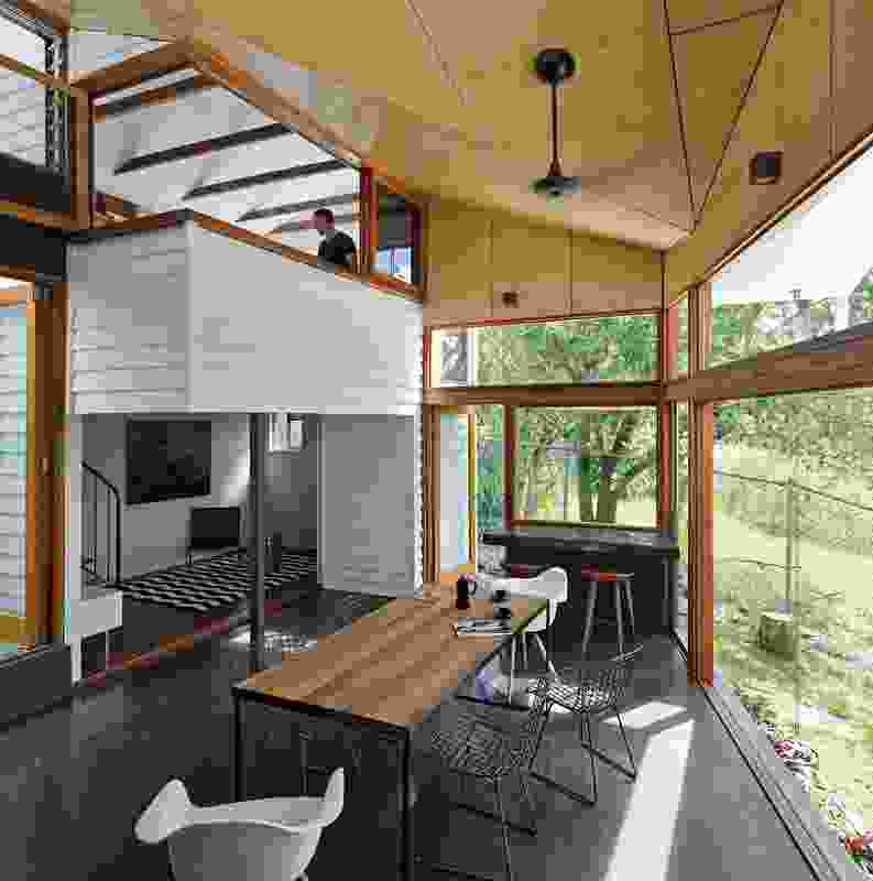 """The In-Between Room (2013) is a """"celebratory transparent chapel room"""" that connects an existing two-storey tower to the original home."""