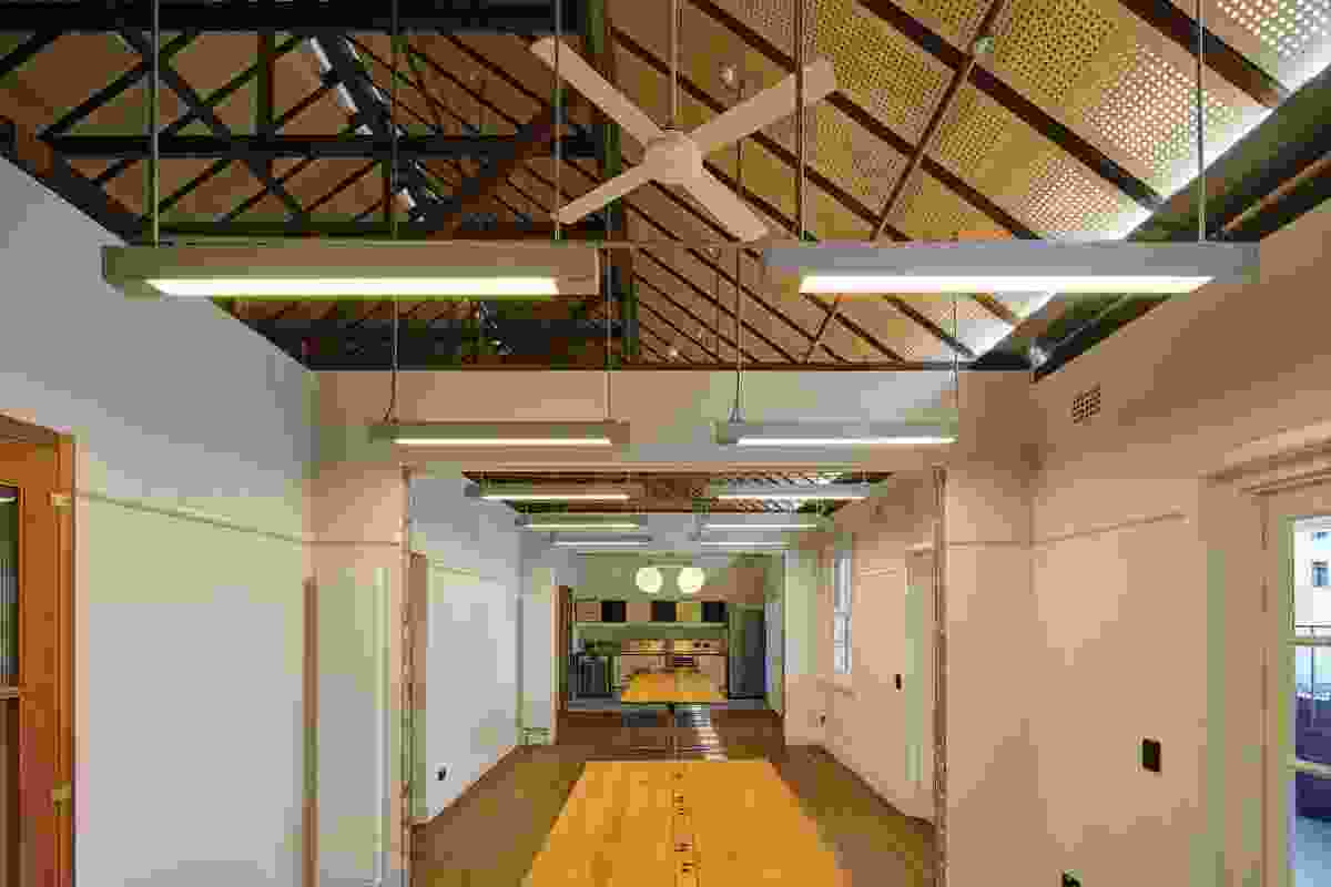 The ceilings of the upper level of the Esme Cahill building have been removed to expose the original timber structure; the peaked structure allows for thermal venting, in keeping with the designer's focus on environmental performance.