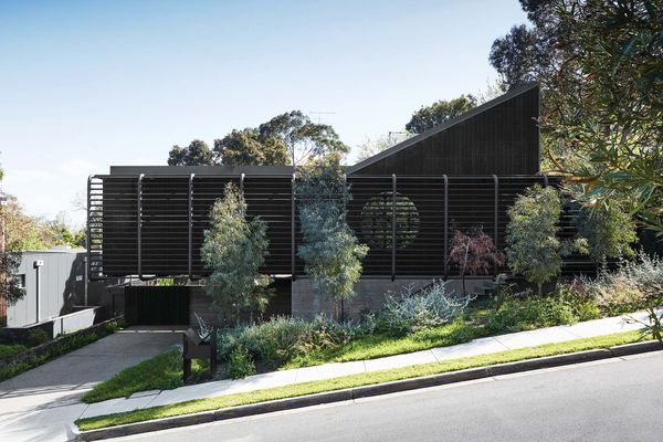 On approach, the home's bold cantilever and porthole window make for a striking composition in the landscape.