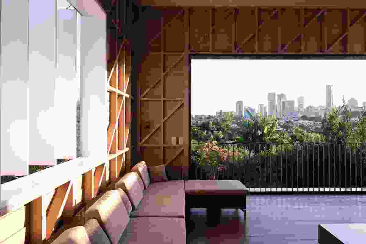 The new outdoor room features exposed bracing and deep shading, and carefully frames the city views beyond.