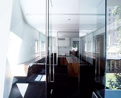 Looking through the narrow interior, showing the layering of the second-level offices.