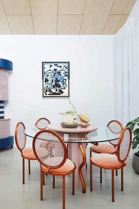 The project's circular motif is evident in the dining table where the circle acts as an enabler of sharing and equality through the application of a terrazzo lazy susan. Artwork: Thomas Jeppe.