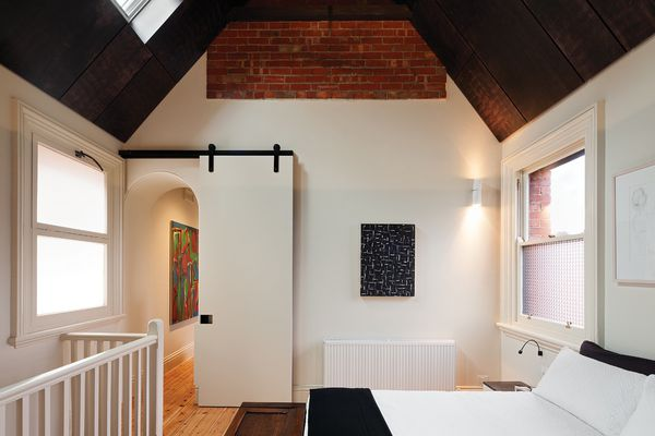 Main bedroom. Artwork (L–R): Dick Watkins, John Peart, Ken Whisson.