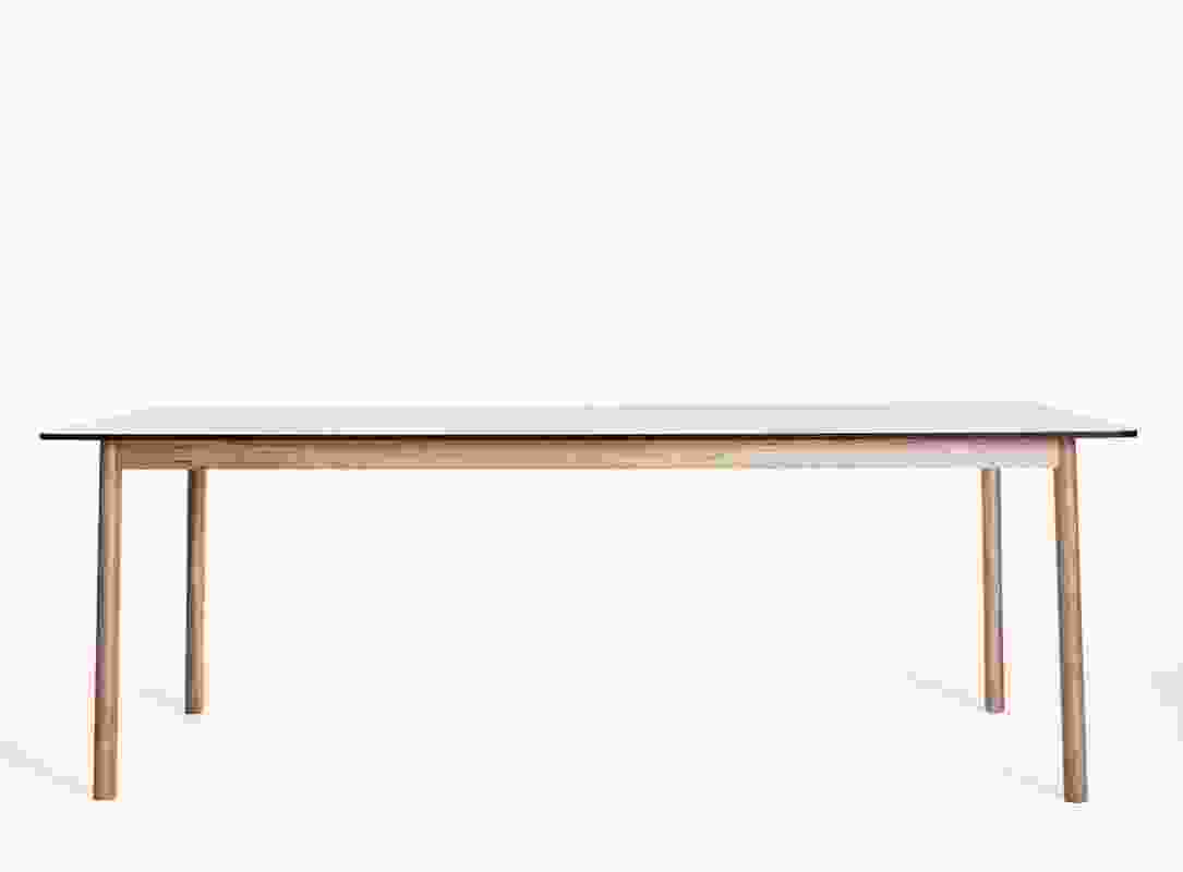 NOMI Time Table by Tomek Archer in American oak with laminate top.
