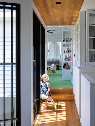 Blackbutt timber is used throughout the house, complementing the light and bright whites and providing warmth