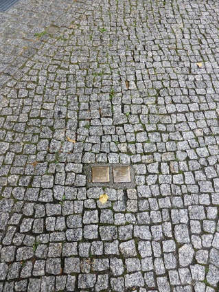 Wounds in the city fabric: stumbling stones in Berlin mark the lives of Holocaust victims and where they once lived.