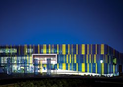 The library forecourt at night, when lighting renders the public facade more transparent.