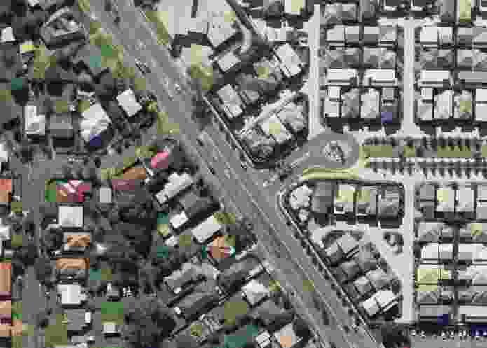 Aerial view showing a housing scheme at Carina, Brisbane, built in 2007–08. Note the older suburban layout with large backyards on the lefthand side of the main road.