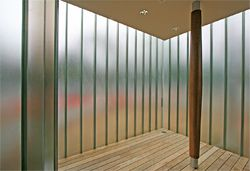 The day-lit lobby features a single column cased in timber.
