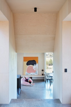 Uniform oiled birch plywood provides a warm and tactile finish, in a house without a single piece of plasterboard. Artwork: Jordana Henry.