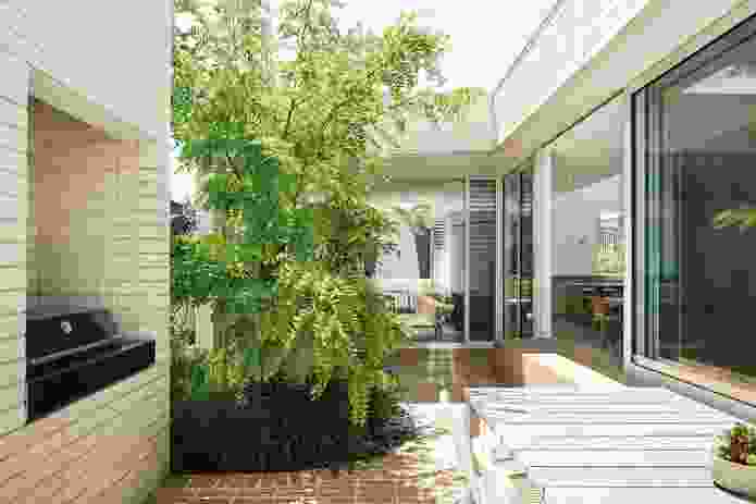 The courtyard that gives the house its name acts as a centralized lung to ventilate the house.