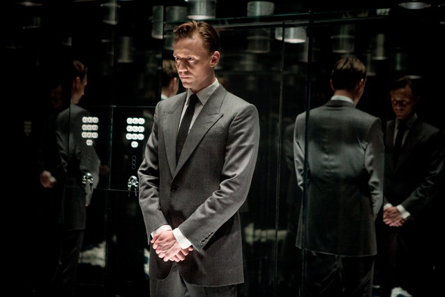 Film still showing Dr Robert Laing (Tom Hiddleston) in the tower block's mirrored lift.