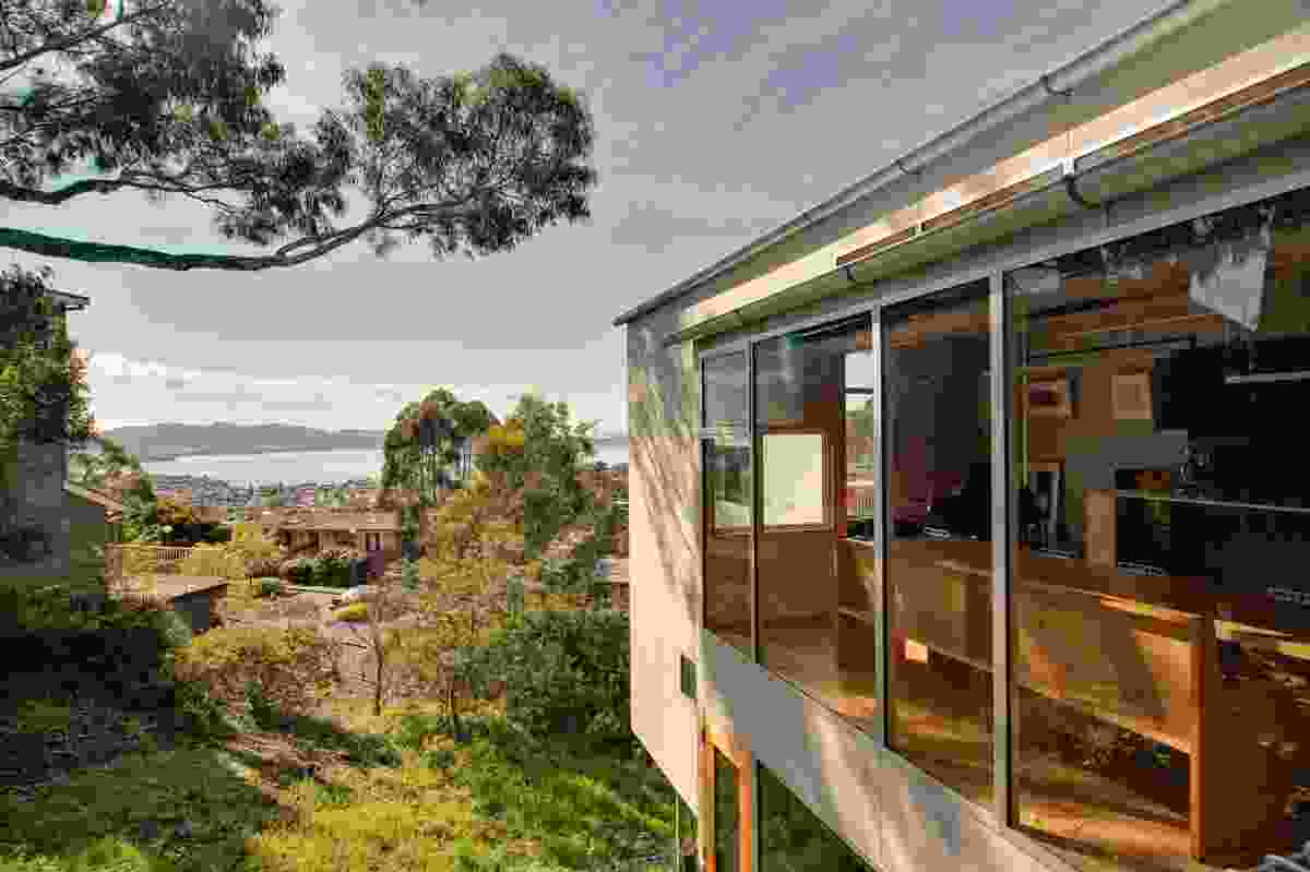 Both houses are oriented toward impressive views of the Derwent River.