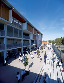 N°2 The larger, stepped, paved courtyard which acts as both sober forecourt and lively school ground.