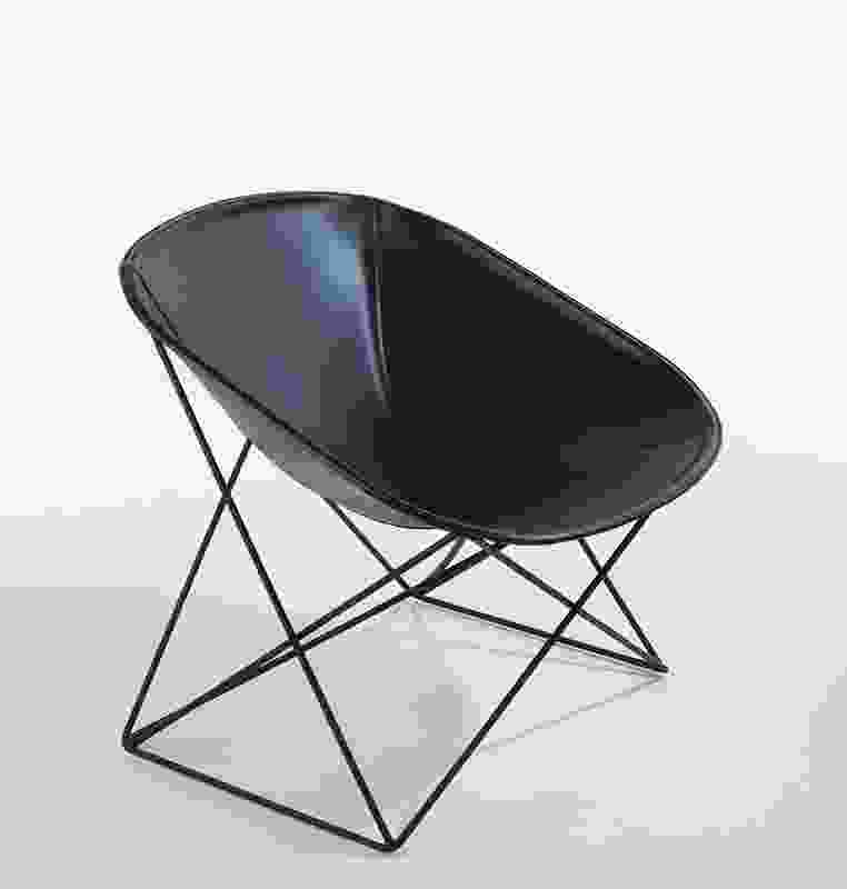 "The Popsi lounge chair for Lema is made up of a leather-covered tub seat on a ""woven"" metal base."