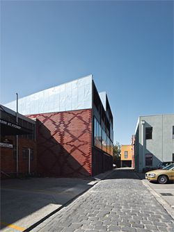 View east along the rear laneway. Patterned brickwork has been used for the exterior wall.Image: Peter Bennetts.