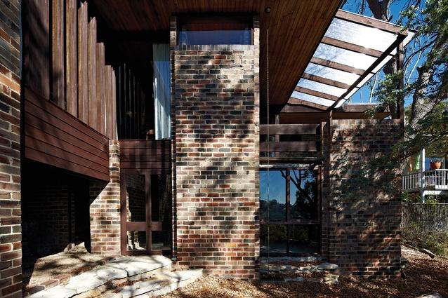 Windows and doors are reddish-brown meranti.