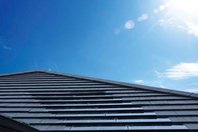 Monier SOLARtile integarted with Monier flat-profile concrete roof tiles.