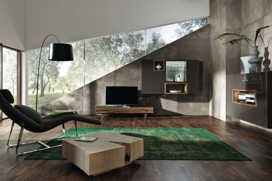 Neo storage and display units by Hülsta mix wood finishes with gloss lacquer and glass.