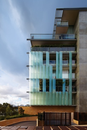 The facade of the Grantham Apartments features glass blades.