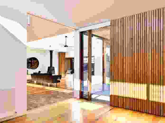 The central living area is accompanied by an adjacent, smaller multipurpose space.