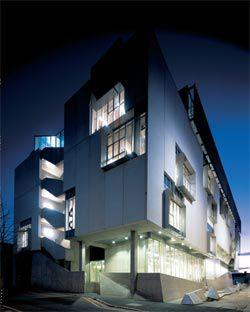 The Dorrit Black Building illuminated at night.