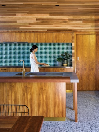 Spotted gum lining, terrazzo floors and custom brass fittings contribute to the refined and delicate interiors.