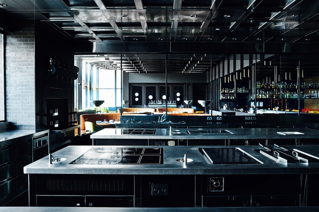 A sizeable team of staff works in the glass-framed open kitchen.