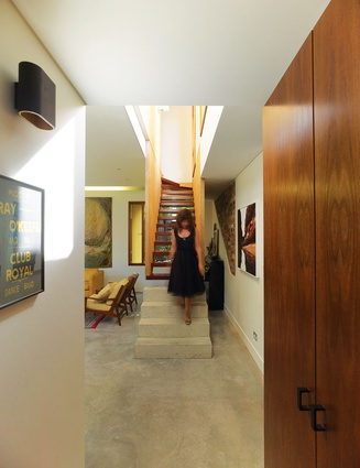 A light void above the staircase draws ample sunlight into the rear addition and upstairs suite.