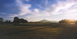 View along the Land Axis with the mound of Reconciliation Place in the foreground and Mt Ainslie beyond. The top of this mound provides a vantage point from which both axes can be simultaneously experienced. Photograph Michael Jensen.