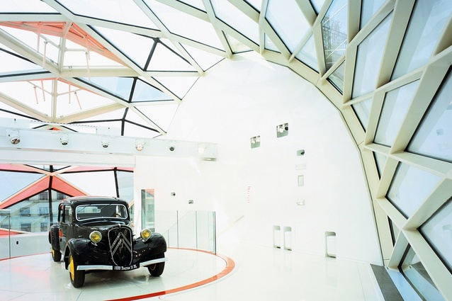 Manuelle Gautrand Citreon Showroom, Paris: a spiral display tower behind glass and fibreglass.