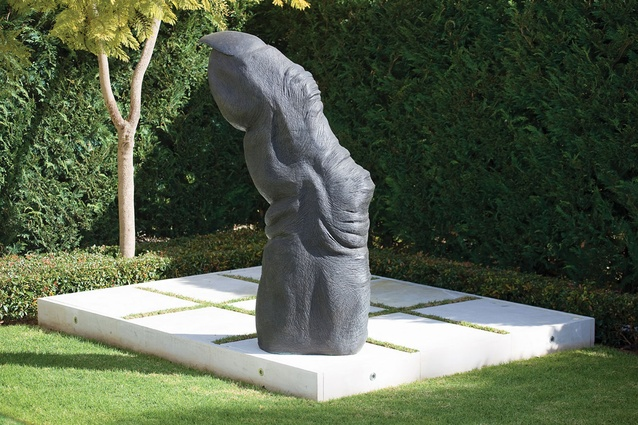 Chimpanzee Finger by Lisa Roet sits on a platform in the north Adelaide garden.