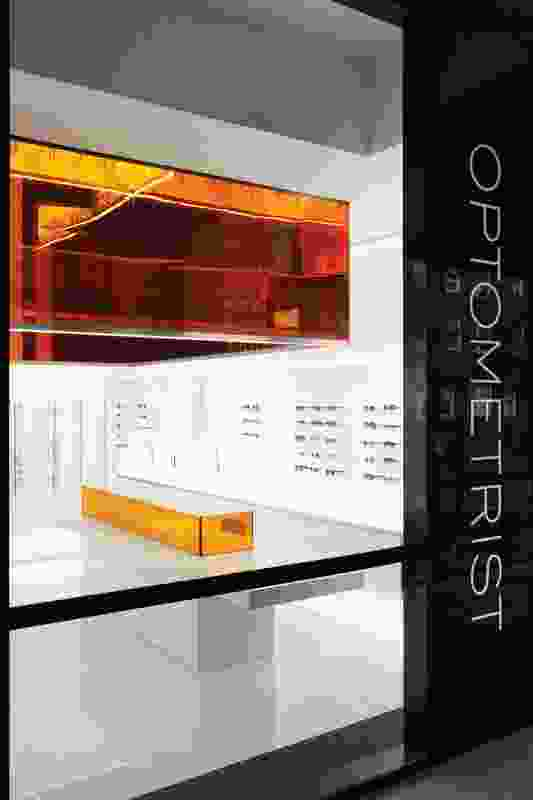The store is effectively a white cube that incorporates orange and purple glass, creating a luxurious interior.