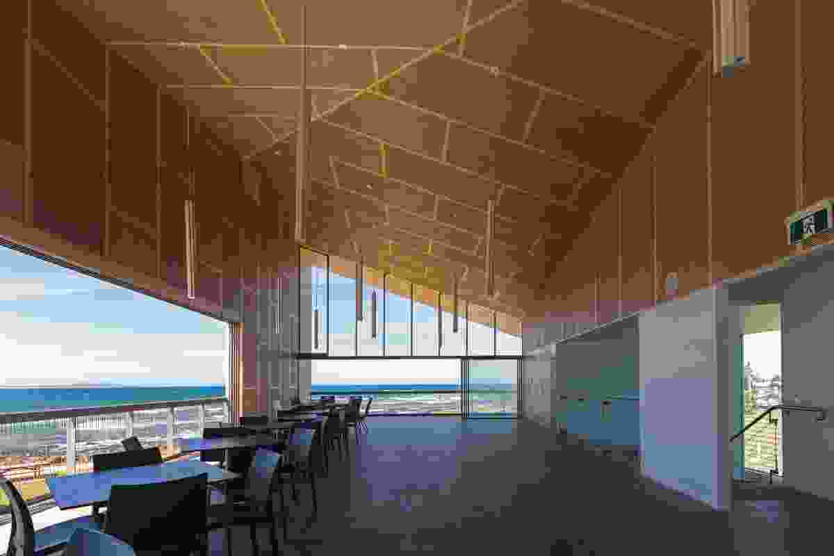 The upper level, hosting a large function space for weddings and other events, is clad in MDF panels with a hoop-pine veneer.
