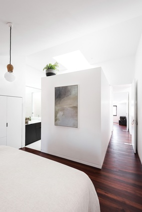 The raked roofline helps to craft angular, attic-like bedrooms that retain a sense of privacy. Artwork: Jordy Hewitt.