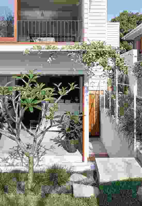 An elegant metal trellis, which will create a green enclosure as the vines grow, shades the terrace.