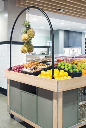 The store has a light palette, making fresh produce stand out.
