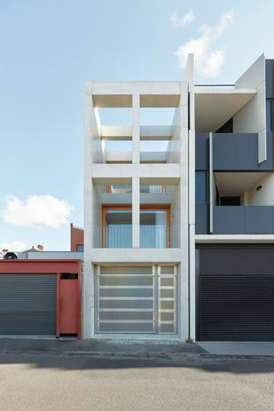 Skinny House unfolds over three levels, with public areas on the bottom floor and private bedrooms on the top.