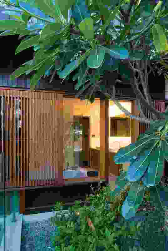 Sliding timber batten screens in the Samford House temper light and let the house breath.
