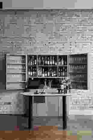 A champagne bar greets guests in the front bar.