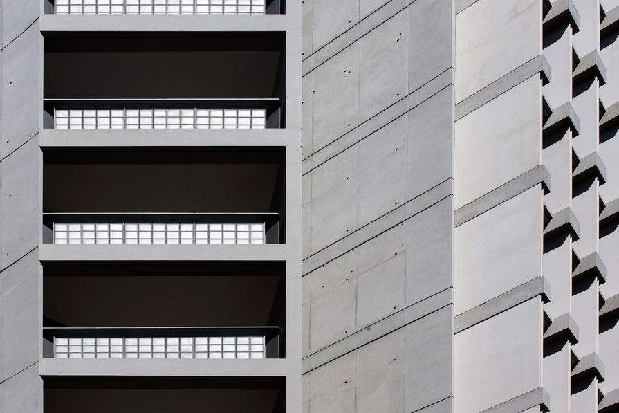 The rhythmic and sculptural use of off-form concrete adds visual interest to the building.