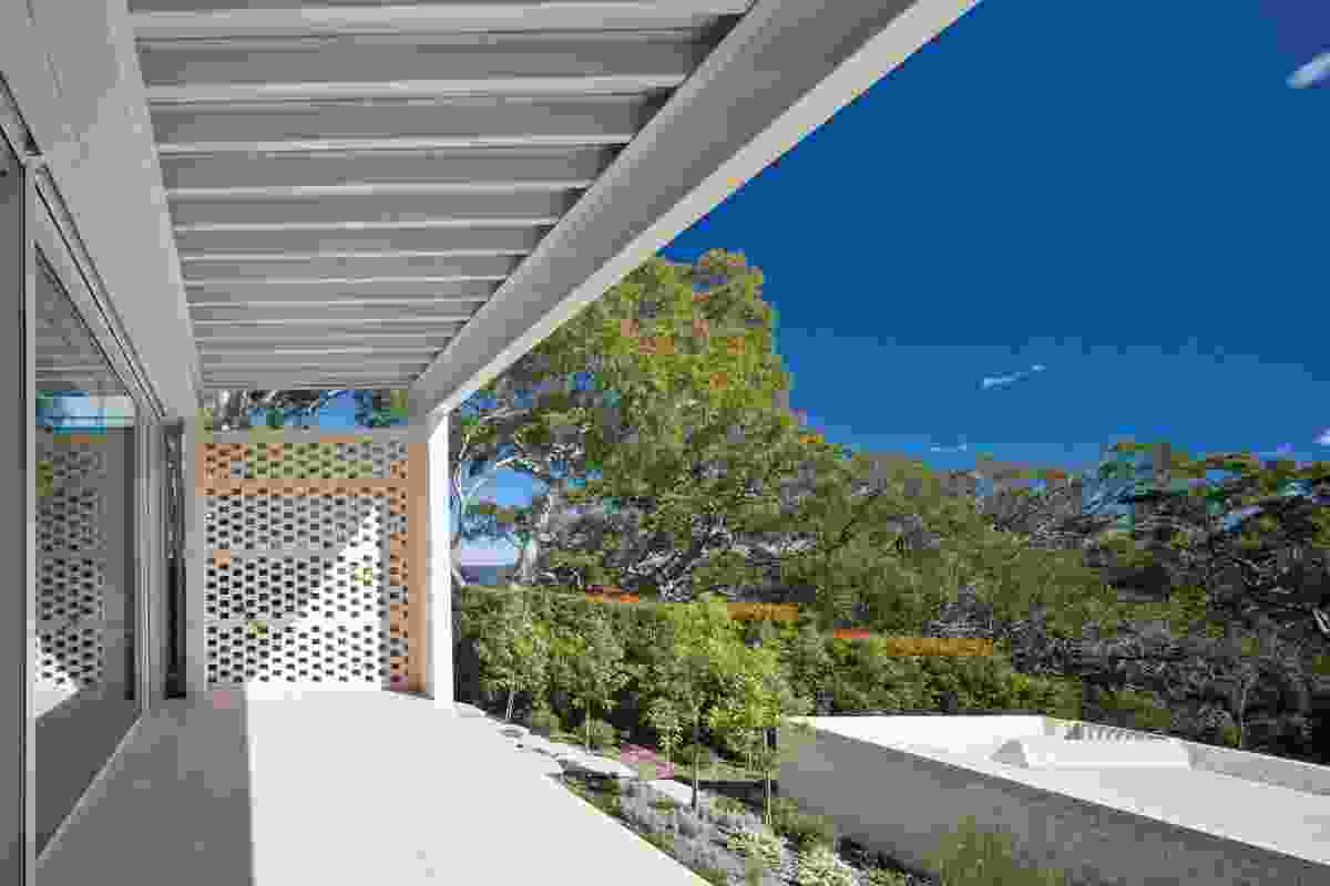 The broad balcony roof line frames the bush view.