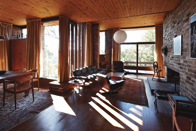 The main living area features cypress pine ceilings, clinker brick walls and tallowwood floors. This shows where Glenn Murcutt raised the originally sunken floor to be level with the dining room.