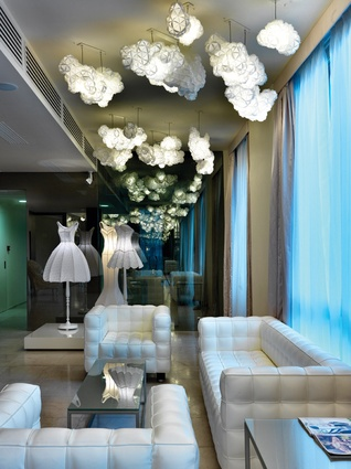 The lobby with cloud-like lights and lampshade dresses.