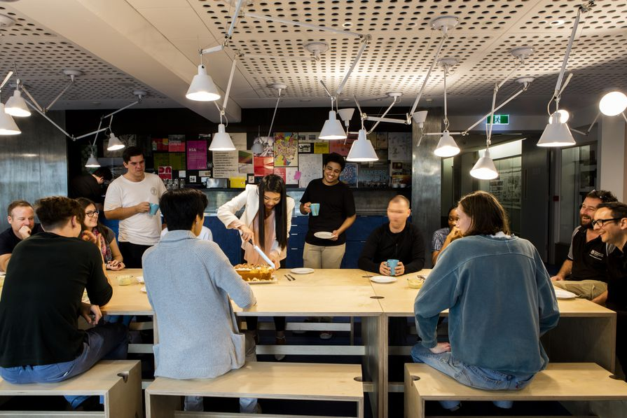Staff and students share morning tea together in the University of Queensland's School of Architecture, recently renovated by m3architecture.
